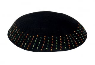 Black DMC knitted kippah with colorful border by JudaicaDirect